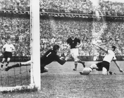 Morlock, West Germany's inside-right, scores against Hungary in the World Cup Final at Berne, Switzerland. Germany went on to become World Champions with a 3-2 victory. (Photo by Keystone/Getty Images)