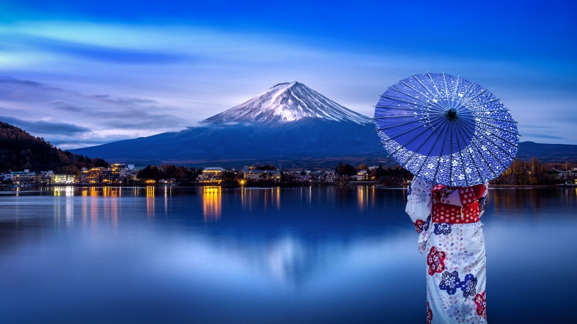 Asian woman wearing japanese traditional kimono at Fuji mountain, Kawaguchiko lake in Japan.